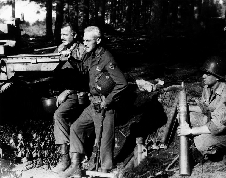 "Ernest Hemingway and Colonel Charles T. ""Buck"" Lanham with captured artillery in Schweiler, Germany, 18 September 1944"